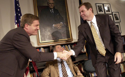 Francisco Kjolseth  |  Tribune file photo  Jim Matheson (D), left, and John Swallow (R) shake hands following a spirited debate moderated by Ted Wilson when the two politicians ran for Congress against each other in 2002. Matheson eventually beat Swallow.