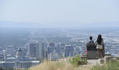 Al Hartmann  |  The Salt Lake Tribune  A couple takes in the hazy view from Ensign Peak above Salt Lake City Tuesday, July 16.  With higher summer temperatures, ozone pollution was considered moderate but approaching the unhealthy level for sensitive groups.
