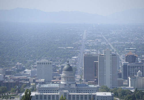 Al Hartmann  |  The Salt Lake Tribune  The view from looking down State Street in Salt Lake City to the end of the Salt Lake Valley from Ensign Peak was hazy Tuesday, July 16. With higher summer temperatures, ozone pollution was considered moderate but approaching the unhealthy level for sensitive groups.