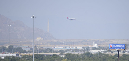 Al Hartmann  |  The Salt Lake Tribune  A commercial jet approaches the Salt Lake City International Airport Tuesday, July 16.  With higher summer temperatures, ozone pollution was considered moderate but approaching the unhealthy level for sensitive groups.