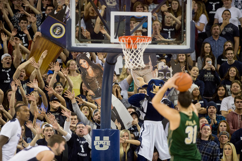 Trent Nelson  |  The Salt Lake Tribune Utah State fans try to distract Colorado State Rams forward J.J. Avila (31) as Utah State University hosts Colorado State, NCAA basketball, Wednesday January 15, 2014 in Logan.