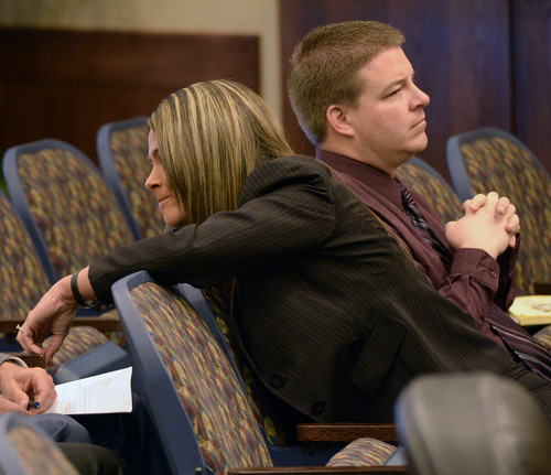 Al Hartmann  |  The Salt Lake Tribune  Defense lawyer Lindsay Jarvis, left, represents Shaun Cowley in a pre-hearing conference before the West Valley City Civil Service Commission Tuesday February 18, 2014.  Shaun Cowley is fighting to get back on the West Valley City Police force.