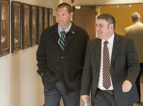 Rick Egan  |  The Salt Lake Tribune  John Coyle (left) leaves the West Valley City civil service commission hearing with attorney Blake Hamilton, Thursday, May 15, 2014. The civil service commission overturned the demotion of Lt. Coyle and ordered the department to award him back pay.