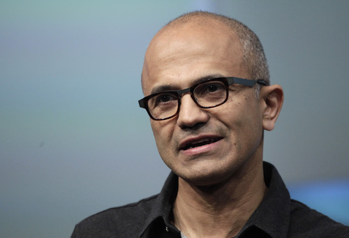 FILE- In this May 20, 2014 file photo, Satya Nadella, CEO of Microsoft, talks during the introduction the Surface Pro 3 tablet device at a media preview in New York. Microsoft on Thursday, July 17, 2014 announced it will lay off 18,000 workers over the next year. (AP Photo/Mark Lennihan, File)