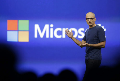 CORRECTS TO SAY THAT MICROSOFT WILL ELIMINATE UP TO 18,000 INSTEAD OF 18,000 - FILE - In this April 2, 2014 file photo, Microsoft CEO Satya Nadella gestures during the keynote address of the Build Conference in San Francisco. Microsoft on Thursday, July 17, 2014 announced it will lay off up to 18,000 workers over the next year. (AP Photo/Eric Risberg, File)