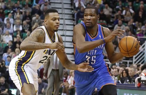 Oklahoma City Thunder forward Kevin Durant (35) is defended by Utah Jazz guard Brandon Rush (25) during the first half of an NBA basketball game in Salt Lake City, Tuesday, Jan. 7, 2014. (AP Photo/Jim Urquhart)