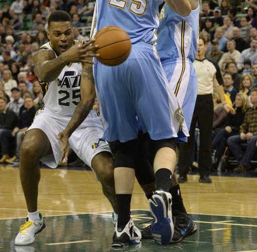 Rick Egan  | The Salt Lake Tribune   Utah Jazz shooting guard Brandon Rush (25) fires a pass to Utah Jazz center Enes Kanter (0) for an assist, in NBA action, Utah Jazz Vs.The Denver Nugget's, inSalt Lake City, Monday, January 13, 2014.