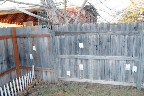 (Investigation photos)  Tags mark bullet holes in the fence outside Matthew David Stewart's house in Ogden following a shootout with police on January 4, 2012.
