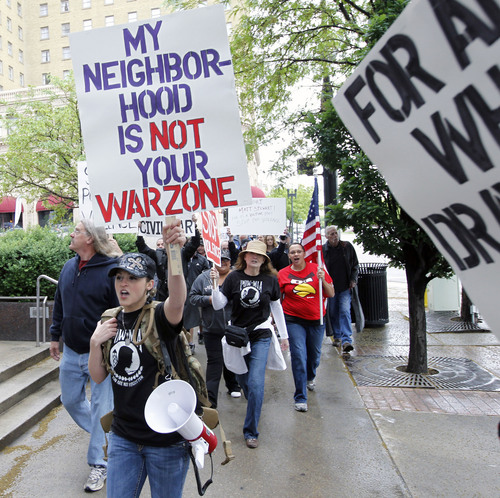 "Al Hartmann  |  Tribune file photo Erna Stewart, sister-in-law of  accused police killer Matthew David Stewart  leads a rally of supporters Friday May 18, 2012, decrying the ""home-invasion style"" search warrant service they feel led to the January shooting of Ogden policemen."
