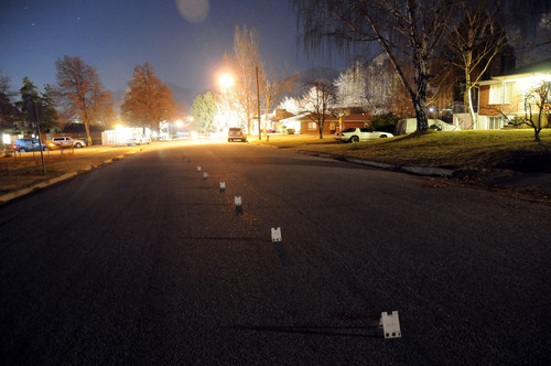 (Investigation photos)  Evidence markers form a line down the middle of the street outside Matthew David Stewart's house in Ogden after a shootout with police on January 4, 2012.