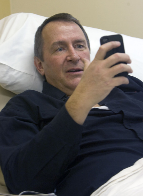 AL HARTMANN | The Salt Lake Tribune file Utah Attorney General Mark Shurtleff was in good spirit as he started his first chemotherapy infusion treatment Monday at the  Jordan Valley Hospital Office of Utah Cancer Specialists. Shurtleff multi-tasks on his phone just before the chemo therapy is delivered.