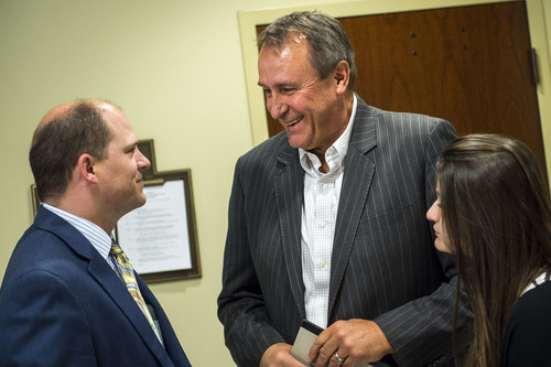 Chris Detrick  |  The Salt Lake Tribune Former Attorney General Mark Shurtleff and his daughter Annie talk to Sen. Daniel W. Thatcher (R-West Valley City) after a committee hearing at the State Capitol Wednesday June 18, 2014.