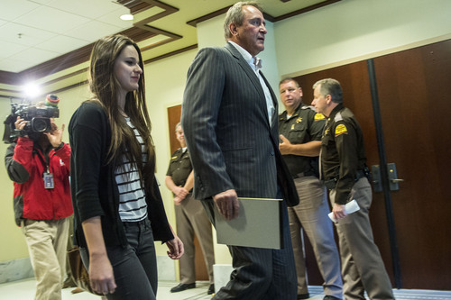 Chris Detrick  |  The Salt Lake Tribune Former Attorney General Mark Shurtleff and his daughter Annie walk outside after a committee hearing at the State Capitol Wednesday June 18, 2014.