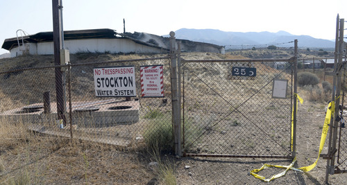 Al Hartmann  |  The Salt Lake Tribune  Stockton water tank roof was burned in the 179 acre fire yesterday Wednesday July 16 necessitating a no use water rule for part of town.