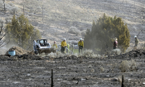 Al Hartmann  |  The Salt Lake Tribune  Wild land fire fighters from several fire agencies finished mopping up the hot spots of the 179 acre fire east of Stockton Thursday July 17.  The town's water tank was burned in the fire necessitating a no use water rule for part of town.