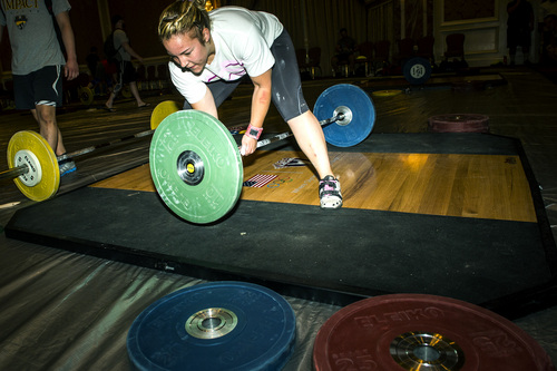Chris Detrick  |  The Salt Lake Tribune Maegan Snodgrass, of Salt Lake City, adds more weights while practicing the snatch before competing in the USA Weightlifting National Championships at The Grand America Hotel Thursday July 17, 2014.