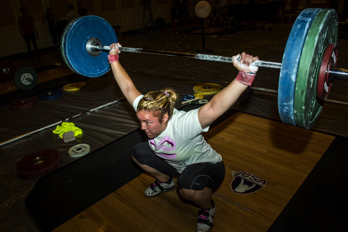 Chris Detrick  |  The Salt Lake Tribune Maegan Snodgrass, of Salt Lake City, practices the snatch before competing in the USA Weightlifting National Championships at The Grand America Hotel Thursday July 17, 2014.