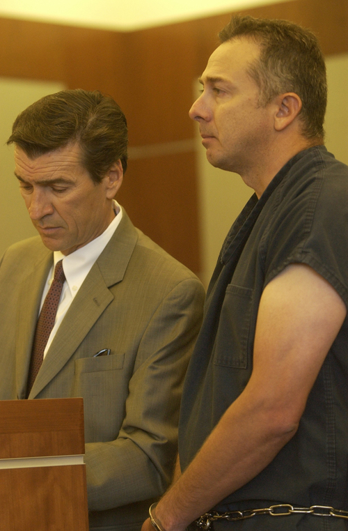 Reginald Campos, right, who is charged with attempted murder and aggravated assault, and the defense attorney Greg Skordas stand before the judge at a hearing in the 3rd District Court on Wednesday, July 29, 2009. Campos' bail was lowered from 500,000 to 100,000. Anna Kartashova / The Salt Lake Tribune