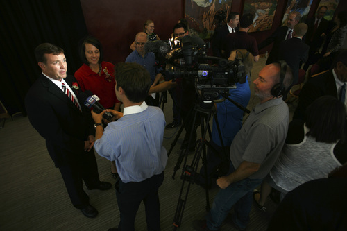 "Jud Burkett | The Spectrum & Daily News  Richard ""Biff"" Williams, chats with members of the media shortly after the announcement was made naming as the new president of Dixie State University Thursday, July 17, 2014."