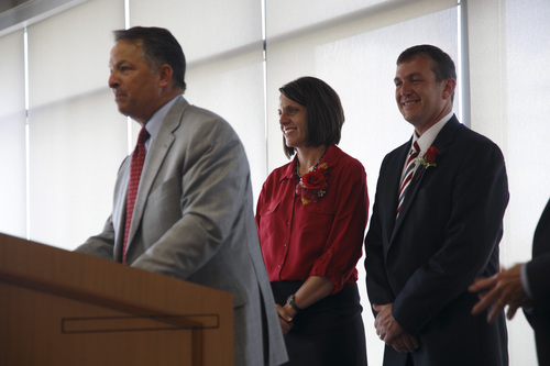 "Jud Burkett | The Spectrum & Daily News  Utah Board of Regents Chair Daniel Campbell. left, introduces the new President of Dixie State University, Richard ""Biff"" Williams, and his wife, Kristin on the campus of Dixie State University Thursday, July 17, 2014."