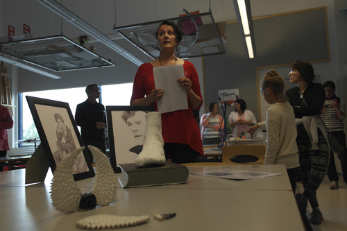 Merinda Davis |  courtesy photo Art teacher Mari Sarviaho at Aleksis Kevi School in Siuntio, Finland, presents student art work to Utah teachers. Teachers toured Finnish schools and discussed cultural and educational philosophies to help improve education.