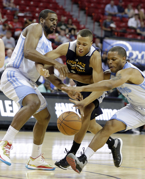 Utah Jazz's Dante Exum, center, reaches for a loose ball with Denver Nuggets' Will Thomas, left, and Chris Wright during the first half of an NBA summer league basketball game Tuesday, July 15, 2014, in Las Vegas. (AP Photo/Isaac Brekken)