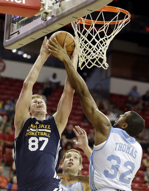 Utah Jazz's Brock Motum (87) shoots covered by Denver Nuggets' Will Thomas (32) during the first half of an NBA summer league basketball game Tuesday, July 15, 2014, in Las Vegas. (AP Photo/Isaac Brekken)