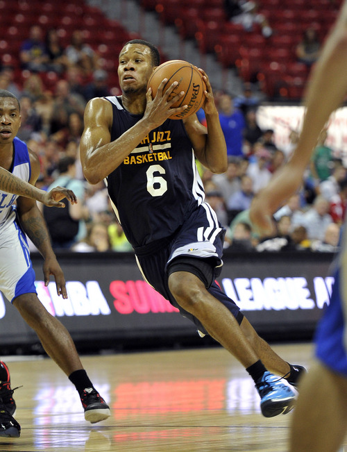 Utah Jazz's Rodney Hood (6) drives to the basket against the Philidelphia 76ers during an NBA summer league basketball game on Saturday, July 12, 2014, in Las Vegas. (AP Photo/David Becker)