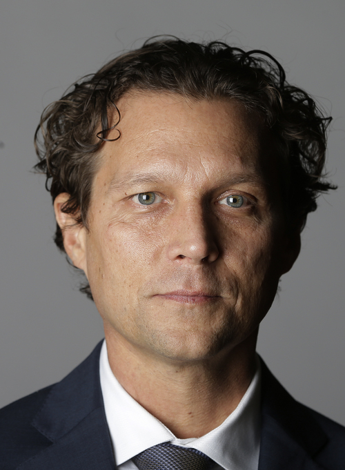 FILE -This Sept. 30, 2013, file photo shows Atlanta Hawks assistant coach Quin Snyder during their NBA basketball media day, in Atlanta. The Utah Jazz announced Friday that they have hired Atlanta Hawks assistant coach Snyder to replace Tyrone Corbin, who was let go earlier this year after three-plus seasons in Salt Lake City. Snyder most recently completed his first season as an assistant with Atlanta. (AP Photo/John Bazemore, File)