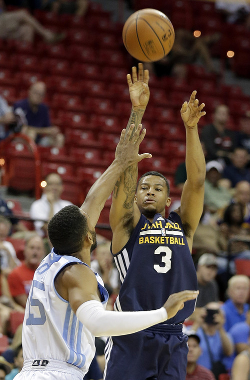 Denver Nuggets' Carlon Brown (15) covers a shot from Utah Jazz's Trey Burke (3) during the first half of an NBA summer league basketball game Tuesday, July 15, 2014, in Las Vegas. (AP Photo/Isaac Brekken)