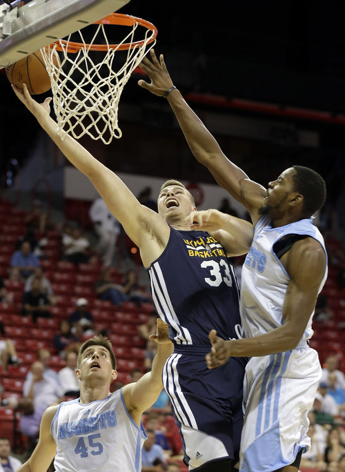 Utah Jazz's Erik Murphy (33) shoots covered by Denver Nuggets' Denzel Bowles (31) during the first half of an NBA summer league basketball game Tuesday, July 15, 2014, in Las Vegas. (AP Photo/Isaac Brekken)