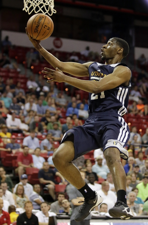 Utah Jazz's Ian Clark goes up for a shot against the Milwaukee Bucks during the second half of an NBA summer league basketball game Monday, July 14, 2014, in Las Vegas. (AP Photo/John Locher)