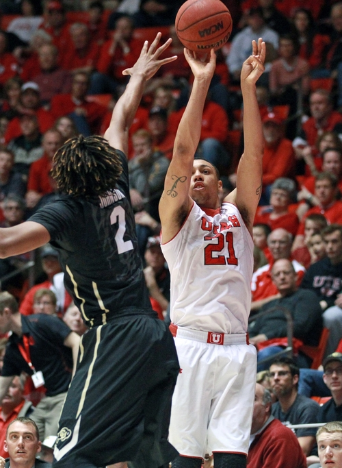 Utah's forward Jordan Loveridge (21) shoots as Colorado's forward Xavier Johnson (2) defends in the second half of an NCAA college basketball game Saturday, March 1, 2014, in Salt Lake City. Utah won 75-64. (AP Photo/Rick Bowmer)
