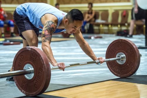 Chris Detrick  |  The Salt Lake Tribune Dustin Ma, of Sandy, practices the snatch before competing in the USA Weightlifting National Championships at The Grand America Hotel Thursday July 17, 2014.