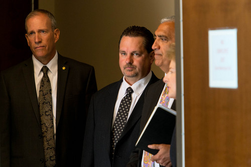 Trent Nelson  |  The Salt Lake Tribune Public Safety Commissioner Keith Squires, Davis County Attorney Troy Rawlings, Salt Lake County District Attorney Sim Gill, and Mary Rook, special agent in charge of the FBI office in Salt Lake City prepare to announce the arrest of former Utah Attorneys General Mark Shurtleff and John Swallow at a press conference at FBI headquarters in Salt Lake City, Tuesday July 15, 2014.
