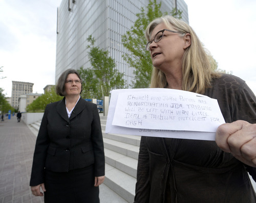 Al Hartmann  |  The Salt Lake Tribune Former Tribune staffer Joan O'Brien with lawyer Karra Porter pause on the steps of the Federal Courthouse in Salt Lake City in June after filing an injunction in U.S District Court seeking an injunction blocking the paper's new profit-sharing split and other key provisions of the partnership with the Deseret News. She holds an anonymous letter sent to reporters at the Tribune before the change of the profit sharing split was changed.