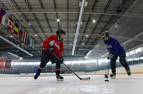 Scott Sommerdorf   |  The Salt Lake Tribune Pee Wee hockey players, Markus Zeba, left, and James Colbert practice after a game at the Olympic Oval, Friday, July 18, 2014. Solar panels being built atop a new parking garage to the south of the building will help defray $100,000 in electrical bills annually at the Utah Olympic Oval in Kearns.
