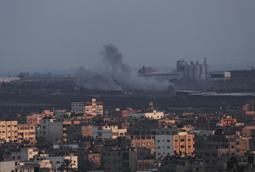 Smoke rises after an Israeli missile strike in Gaza City, Saturday, July 19, 2014. Gaza Health Ministry spokesman Ashraf al-Kidra said the new round of strikes raised the death toll from the 12-day offensive to more than 330 Palestinians, many of them civilians. (AP Photo/Adel Hana)