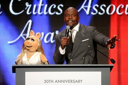(TCA photo)  Miss Piggy and Terry Crews sing at the 30th Annual Television Critics Association Awards.