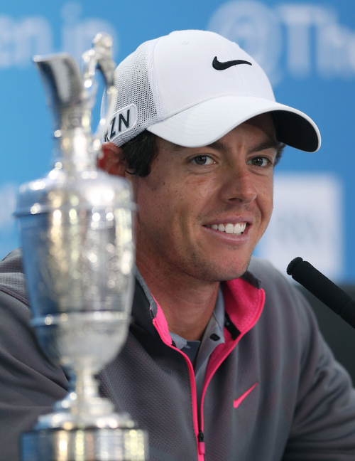 Rory McIlroy of Northern Ireland attends a press conference after winning the British Open Golf championship at the Royal Liverpool golf club, Hoylake, England, Sunday July 20, 2014. (AP Photo/Jon Super)