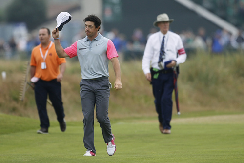 Rory McIlroy of Northern Ireland acknowledges the crowd as he walks up to the 18th green during the final round of the British Open Golf championship at the Royal Liverpool golf club, Hoylake, England, Sunday July 20, 2014. (AP Photo/Peter Morrison)