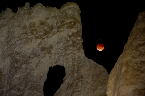 Franciso Kjolseth  |  The Salt Lake Tribune The moon is eclipsed by the Earth's Shadow early Tuesday morning as seen from Bryce Canyon near the E.T. formation as it is affectionately known by the local rangers. Bryce Canyon, famed for its dark skies is a great place to marvel at the stars and this week's blood moon.