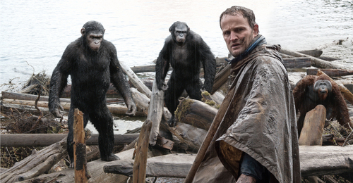 """This photo released by Twentieth Century Fox Film Corporation shows Jason Clarke, as Malcolm, foreground, and, background from left, Andy Serkis, as Caesar; Toby Kebbell, as Koba; and Karin Konoval, as Maurice; in a scene from the film, """"Dawn of the Planet of the Apes."""" (AP Photo/Twentieth Century Fox Film Corporation)"""
