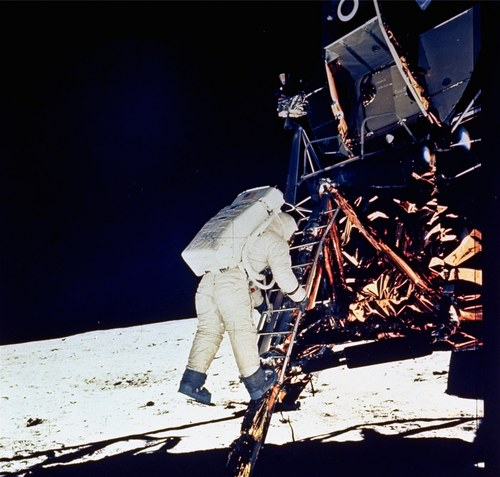 Astronaut Edwin E. Aldrin, Jr., lunar module pilot, descends steps of Lunar Module ladder as he prepares to walk on the moon, July 20, 1969. This picture was taken by astronaut Neil A. Armstrong, Commander, with a 70mm surface camera. (AP Photo/NASA/Neil A. Armstrong)