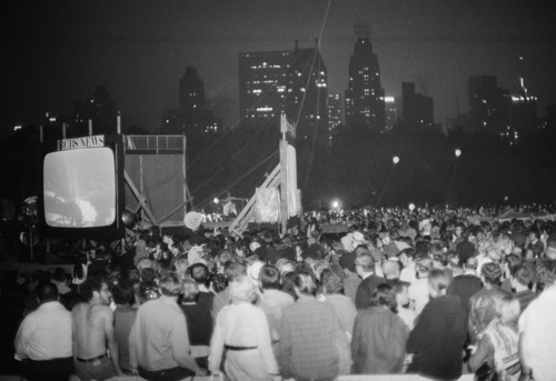 A crowd watches as the Apollo 11 crew lands on the moon, July 20, 1969, Central Park, New York. (AP Photo/Marty Lederhandler)
