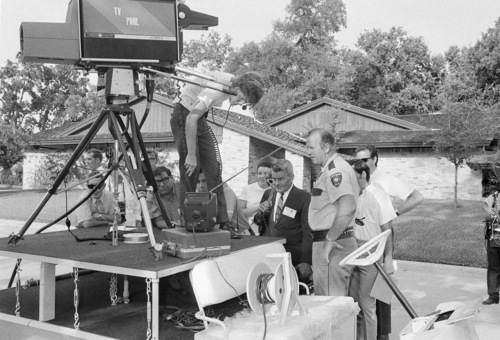 Newsmen and neighbors gather in front of a mobile television unit at the home of Astronaut Michael Collins, near the Manned Spacecraft Center, July 16, 1969, Houston, Texas. They were gathered to watch the blastoff of the Saturn rocket carrying the Apollo 11 spacecraft on its way to the moon. (AP Photo)