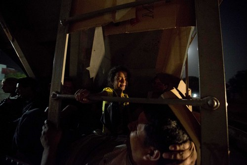 In this July 11, 2014, photo, Central American migrants ride a freight train during their journey toward the U.S.-Mexico border in Chahuites, Mexico. Many children and teenagers who travelled to the United States recently said they did so after hearing they would be allowed to stay. (AP Photo/Eduardo Verdugo)