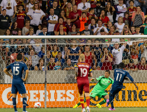 Trent Nelson  |  The Salt Lake Tribune Vancouver's Darren Mattocks (11) gets a penalty kick past Real Salt Lake's Nick Rimando (18) after a penalty by Real Salt Lake's Nat Borchers (6), as Real Salt Lake hosts Vancouver Whitecaps FC at Rio Tinto Stadium in Sandy, Saturday July 19, 2014.