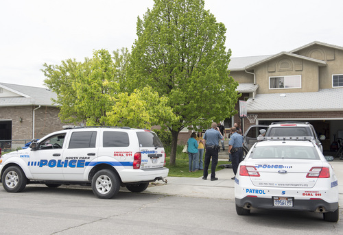 Rick Egan  |  The Salt Lake Tribune  North Park Police and ATF officers stand outside the Jason Burr's house in North Logan on May 16, 2014. Burr is the suspect in a shooting at the Cache Valley Hospital in Logan.