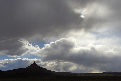 Al Hartmann     The Salt Lake Tribune  North Six-Shooter Peak is cast in shadow as a Spring rain sweeps over the Canyon Rims area just south of U-111.  It is an area up for consideration for inclusion into an expanded Canyonlands National Park.